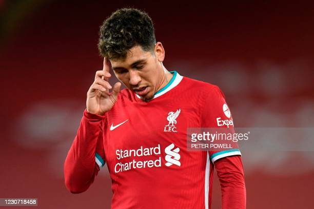 Liverpool's Brazilian midfielder Roberto Firmino reacts during the English Premier League football match between Liverpool and Burnley at Anfield in...