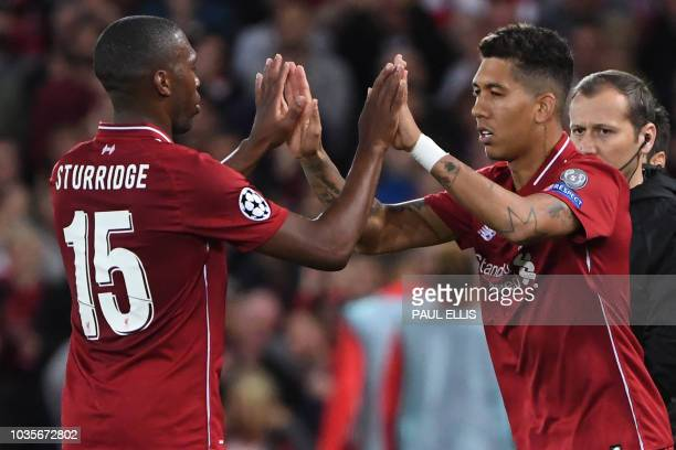 TOPSHOT Liverpool's Brazilian midfielder Roberto Firmino replaces Liverpool's English striker Daniel Sturridge during the UEFA Champions League group...