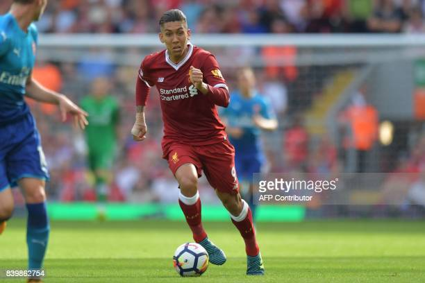 Liverpool's Brazilian midfielder Roberto Firmino runs with the ball during the English Premier League football match between Liverpool and Arsenal at...