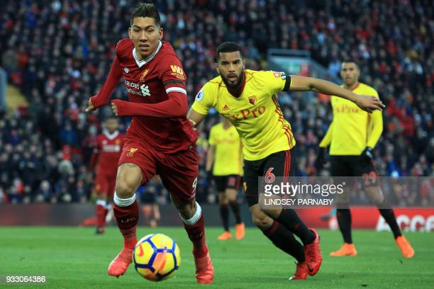 Liverpool's Brazilian midfielder Roberto Firmino controls the ball during the English Premier League football match between Stoke City and Everton at...