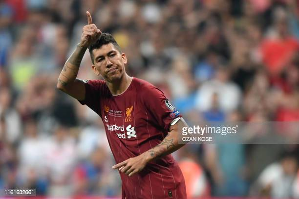 Liverpool's Brazilian midfielder Roberto Firmino scores during the penalty shootout at the UEFA Super Cup 2019 football match between FC Liverpool...