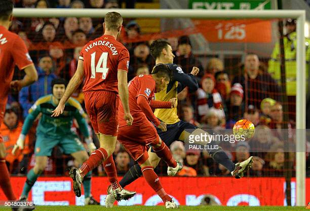 Liverpool's Brazilian midfielder Roberto Firmino scores his second goal during the English Premier League football match between Liverpool and...