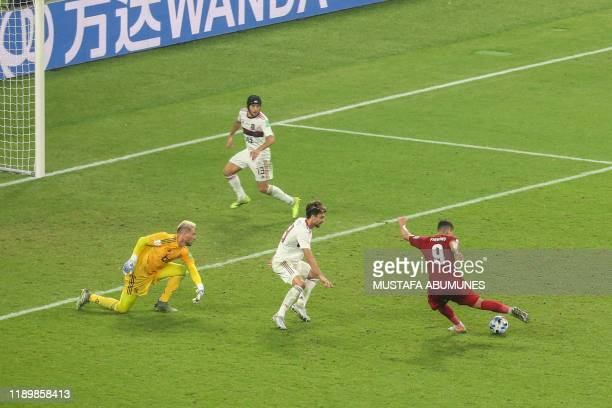 Liverpool's Brazilian midfielder Roberto Firmino shoots to score during the 2019 FIFA Club World Cup Final football match between England's Liverpool...