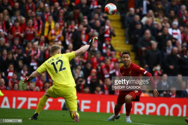 Liverpool's Brazilian midfielder Roberto Firmino takes a shot at goal past Bournemouth's English goalkeeper Aaron Ramsdale during the English Premier...