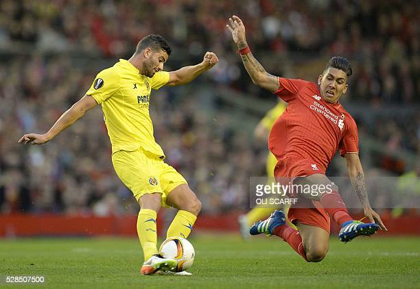 Liverpool's Brazilian midfielder Roberto Firmino vies for the ball against Villarreal's Argentinian defender Mateo Musacchio during the UEFA Europa...