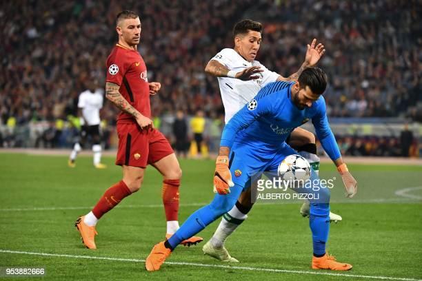 Liverpool's Brazilian midfielder Roberto Firmino vies Roma's Brazilian goalkeeper Alisson during the UEFA Champions League semifinal second leg...
