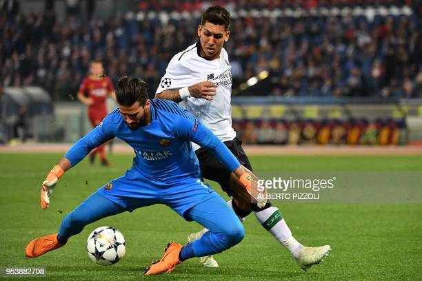 TOPSHOT Liverpool's Brazilian midfielder Roberto Firmino vies Roma's Brazilian goalkeeper Alisson during the UEFA Champions League semifinal second...