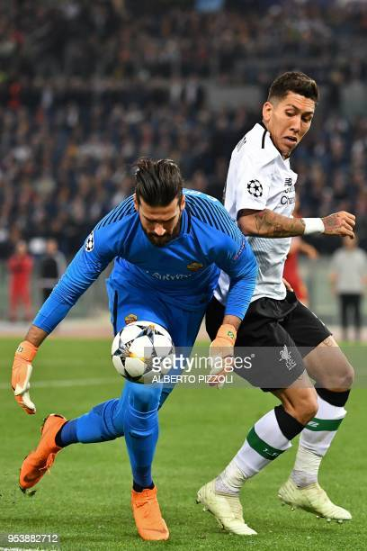 Liverpool's Brazilian midfielder Roberto Firmino vies Roma's Brazilian goalkeeper Alisson during the UEFA Champions League semifinal second leg...