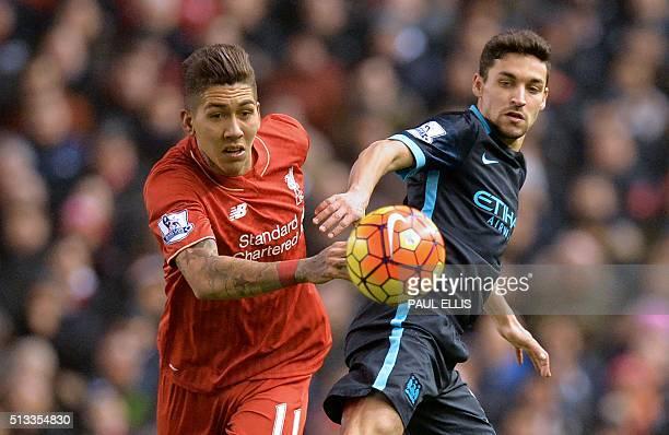 Liverpool's Brazilian midfielder Roberto Firmino vies with Manchester City's Spanish midfielder Jesus Navas during the English Premier League...
