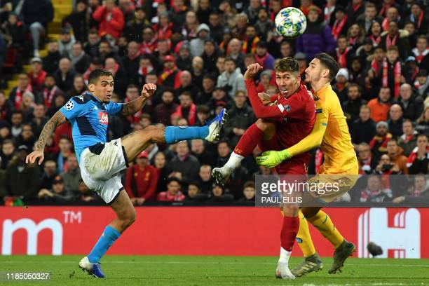 Liverpool's Brazilian midfielder Roberto Firmino vies with Napoli's Brazilian defender Allan and Napoli's Italian goalkeeper Alex Meret during the...