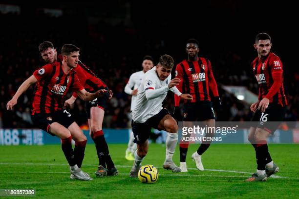 Liverpool's Brazilian midfielder Roberto Firmino wriggles through the Bournemouth defence during the English Premier League football match between...