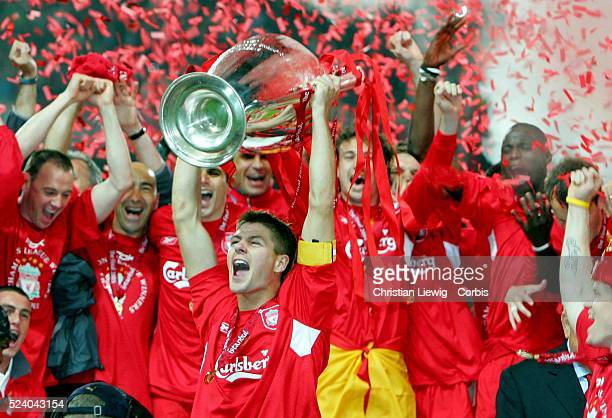 Liverpool's captain Steven Gerrard holds the trophy in front of his team mates after winning the Champions League final soccer match against AC Milan...
