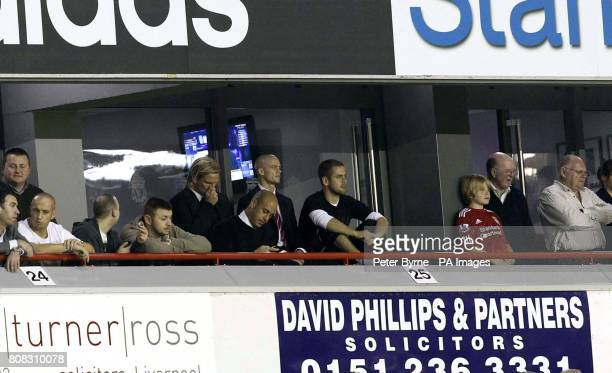 Liverpool's Christian Poulsen Pepe Reina Paul Konchesky and Joe Cole watch from the stands during the third round Carling Cup match at Anfield...