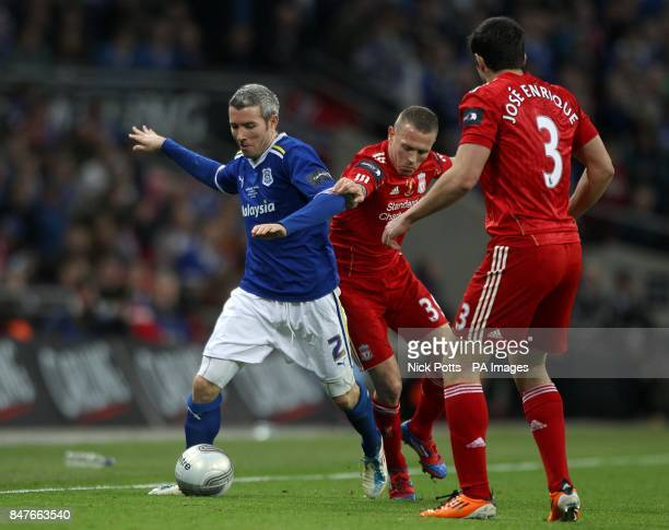 Liverpool's Craig Bellamy and Cardiff City's Kevin McNaughton battle for the ball