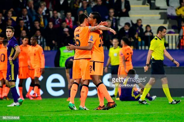 Liverpool's Croatian defender Dejan Lovren and Liverpool's Cameroonian defender Joel Matip celebrate at the end of the UEFA Champions League group E...