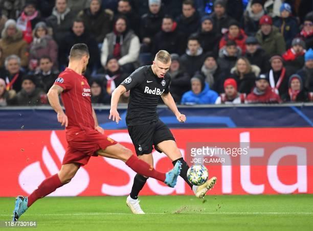 Liverpool's Croatian defender Dejan Lovren and Salzburg's Norwegian forward Erling Braut Haland vie for the ball during the UEFA Champions League...