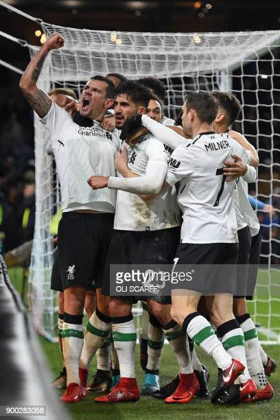Liverpool's Croatian defender Dejan Lovren and teammates celebrate their late winning goal during the English Premier League football match between...