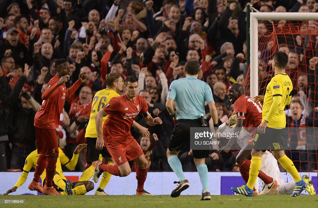 Liverpool's Croatian defender Dejan Lovren (C) celebrates after scoring the winning goal during the UEFA Europa league quarter-final second leg football match between Liverpool and Borussia Dortmund at Anfield stadium in Liverpool on April 14, 2016. / AFP / OLI