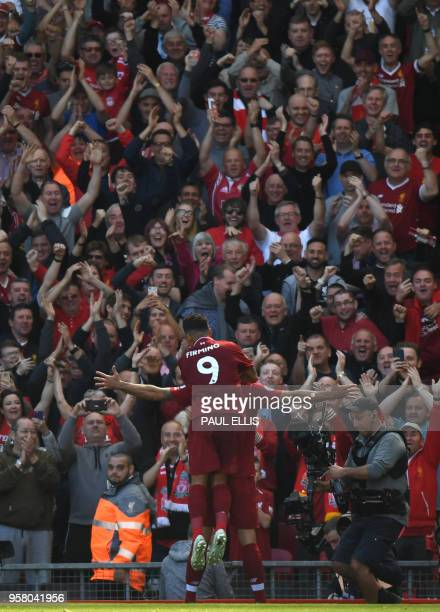 Liverpool's Croatian defender Dejan Lovren celebrates after scoring with Liverpool's Brazilian midfielder Roberto Firmino during the English Premier...