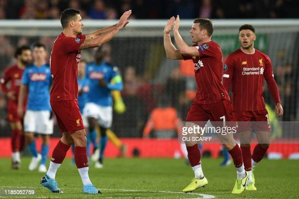 Liverpool's Croatian defender Dejan Lovren celebrates scoring equalising goal during the UEFA Champions league Group E football match between...