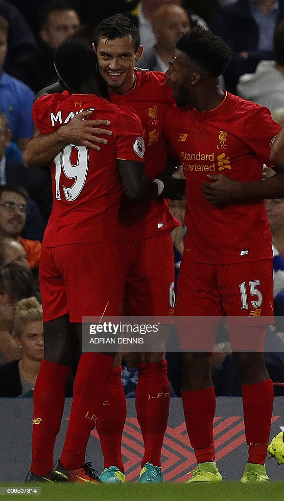 Liverpool's Croatian defender Dejan Lovren (C) celebrates scoring his team's first goal during the English Premier League football match between Chelsea and Liverpool at Stamford Bridge in London on September 16, 2016. / AFP / Adrian DENNIS / RESTRICTED TO EDITORIAL USE. No use with unauthorized audio, video, data, fixture lists, club/league logos or 'live' services. Online in-match use limited to 75 images, no video emulation. No use in betting, games or single club/league/player publications. /