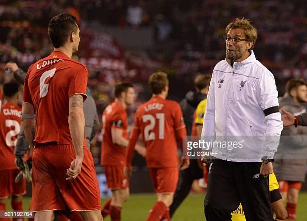 Liverpool's Croatian defender Dejan Lovren celebrates with Liverpool's German manager Jurgen Klopp after winning during the UEFA Europa league...