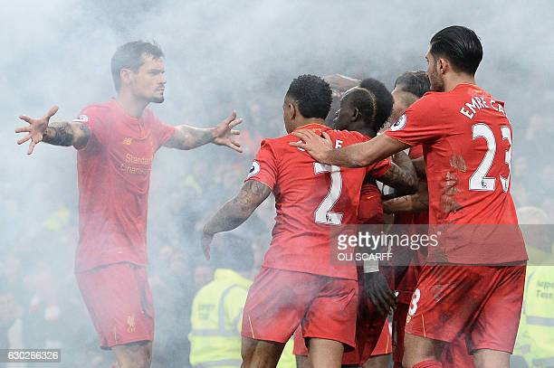 Liverpool's Croatian defender Dejan Lovren congratulates Liverpool's Senegalese midfielder Sadio Mane after he scored the first goal during the...