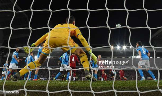 Liverpool's Croatian defender Dejan Lovren heads the ball to score the equalising goal past Napoli's Belgian forward Dries Mertens during the UEFA...