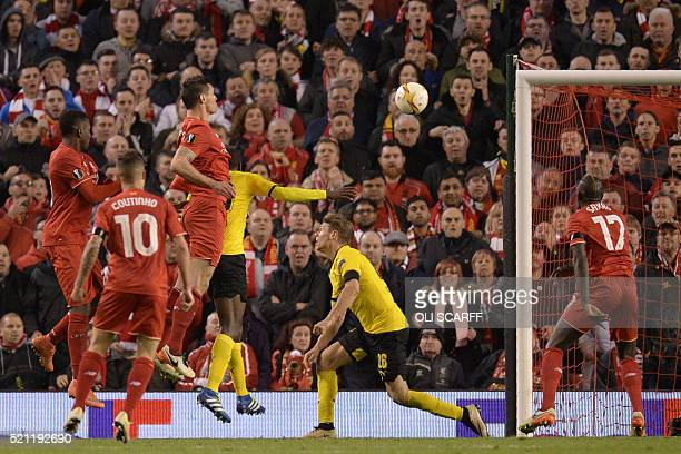 Liverpool's Croatian defender Dejan Lovren heads the ball to score the winning goal during the UEFA Europa league quarterfinal second leg football...