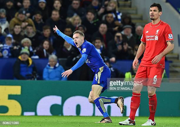Liverpool's Croatian defender Dejan Lovren looks on as Leicester City's English striker Jamie Vardy celebrates scoring the opening goal of the...