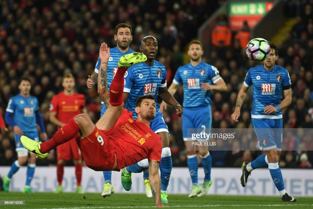 Liverpool's Croatian defender Dejan Lovren misses with this spectacular attempt during the English Premier League football match between Liverpool and Bournemouth at Anfield in Liverpool, north west England on April 5, 2017. / AFP PHOTO / PAUL ELLIS / RESTRICTED TO EDITORIAL USE. No use with unauthorized audio, video, data, fixture lists, club/league logos or 'live' services. Online in-match use limited to 75 images, no video emulation. No use in betting, games or single club/league/player publications. /