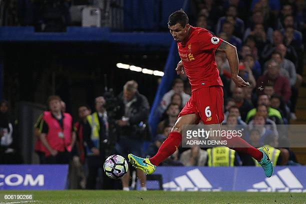Liverpool's Croatian defender Dejan Lovren scores his team's first goal during the English Premier League football match between Chelsea and...