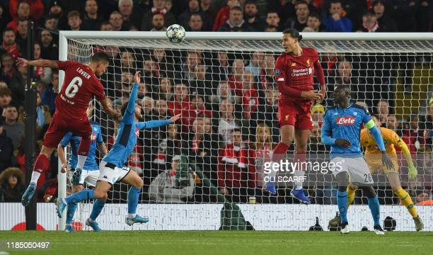 Liverpool's Croatian defender Dejan Lovren scores the equalising goal during the UEFA Champions league Group E football match between Liverpool and...
