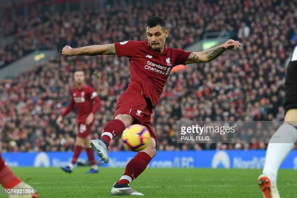 Liverpool's Croatian defender Dejan Lovren shoots to score the opening goal of the English Premier League football match between Liverpool and...