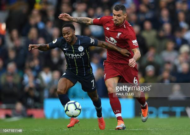Liverpool's Croatian defender Dejan Lovren vies with Manchester City's English midfielder Raheem Sterling during the English Premier League football...