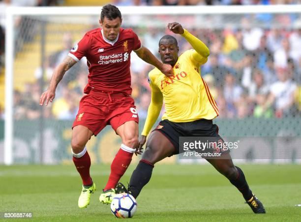 Liverpool's Croatian defender Dejan Lovren vies with Watford's Italian striker Stefano Okaka during the English Premier League football match between...