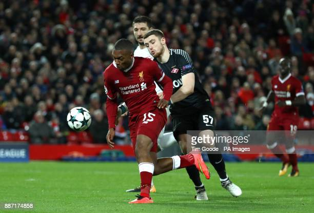 Liverpool's Daniel Sturridge battles for the ball with Spartak Moscow's Alexander Selikhov during the UEFA Champions League Group E match at Anfield...