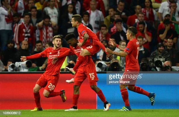 Liverpool's Daniel Sturridge celebrates after scoring the 10 lead with team mates Adam Lallana Philippe Coutinho and Roberto Firmino during the UEFA...