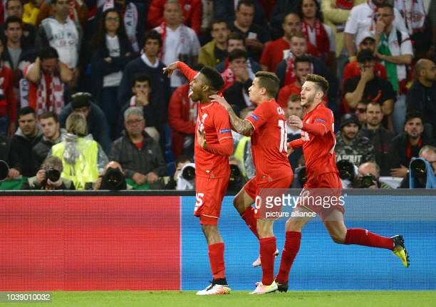 Liverpool's Daniel Sturridge celebrates after scoring the 10 lead with team mates Adam Lallana and Philippe Coutinho during the UEFA Europa League...