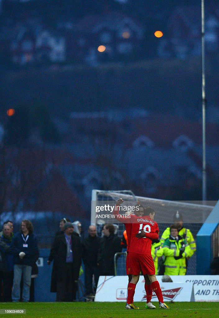 """Liverpool's Daniel Sturridge (back) celebrates with Liverpool's English midfielder Stewart Downing after scoring a goal during the FA Cup third round football match between Mansfield Town and Liverpool at Field Mill in Mansfield, central England, on January 6, 2013. USE. No use with unauthorized audio, video, data, fixture lists, club/league logos or """"live"""" services. Online in-match use limited to 45 images, no video emulation. No use in betting, games or single club/league/player publications."""