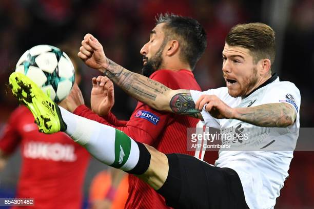 Liverpool's defender from Spain Alberto Moreno and Spartak Moscow's midfielder from Russia Alexander Samedov vie for the ball during the UEFA...
