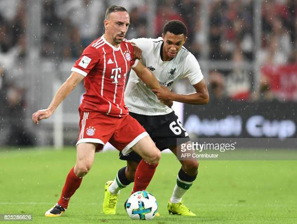 Liverpool's defender Trent AlexanderArnold and Bayern Munich's French midfielder Franck Ribery vie for the ball during the second Audi Cup football...