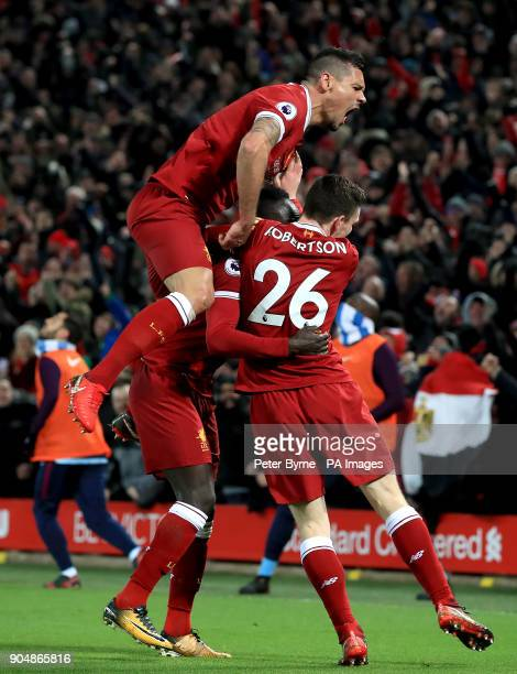 Liverpool's Dejan Lovren and Liverpool's Andrew Robertson celebrate after teammate Sadio Mane scores his side's third goal of the game during the...