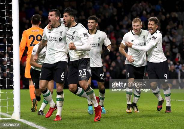 Liverpool's Dejan Lovren and Liverpool's Emre Can celebrate after Liverpool's Ragnar Klavan scores his side's second goal of the game during the...