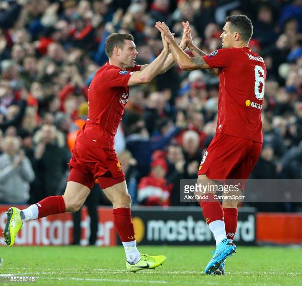 Liverpool's Dejan Lovren celebrates scoring his side's equalising goal to make the score 11 during the UEFA Champions League group E match between...