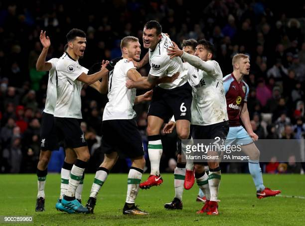 Liverpool's Dejan Lovren celebrates with teammates Dominic Solanke and Emre Can after teammate Ragnar Klavan scores his side's second goal of the...