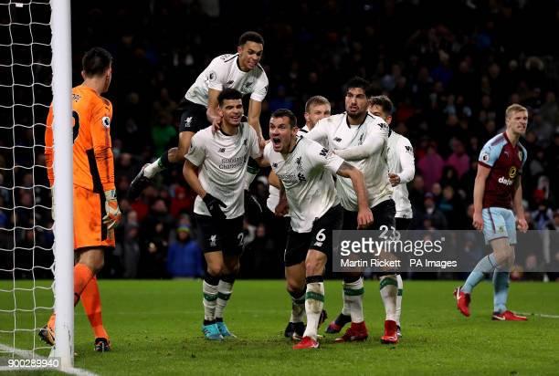 Liverpool's Dejan Lovren celebrates with teammates Dominic Solanke Trent AlexanderArnold and Emre Can after teammate Ragnar Klavan scores his side's...