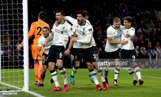 Liverpool's Dejan Lovren Emre Can and Roberto Firmino celebrate after Liverpool's Ragnar Klavan scores his side's second goal of the game during the...
