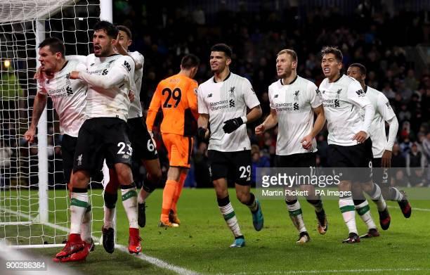 Liverpool's Dejan Lovren Emre Can Dominic Solanke and Roberto Firmino celebrate after Liverpool's Ragnar Klavan scores his side's second goal of the...