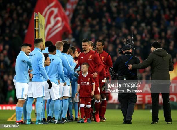 Liverpool's Dejan Lovren shakes hands with Manchester City players before kickoff in the Premier League match at Anfield Liverpool